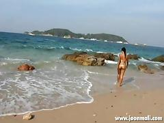 thai girl joon mali teasing on the shore