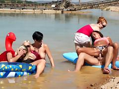 Clothed babes have an orgy in the lake with all kinds of sex