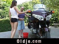 A much older guy gets to bang a teen slut by his motorcycle