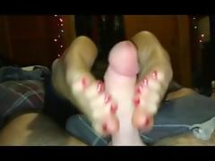 Rubbing cock with her sexy feet