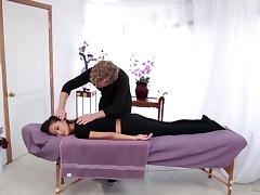 A shy girl seduced to have sex on the massage table