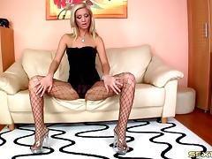 She keeps her heels and fishnets on while fucking two guys at once