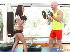 She takes boxing lessons and enjoys her trainer's cock