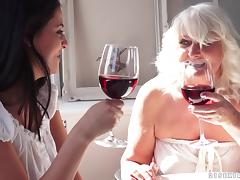 Chubby granny seduces a cute college girl and fucks her