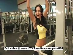 Lovely Busty brunette girl flashing in the gym