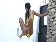 Sexy model peeing from the wall