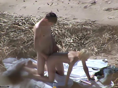 Couple fucks at the beach while guy masturbates