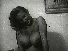Busty Blonde Posing on Her Bed 1950
