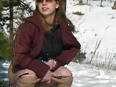 Skirt girl pissing in the snow