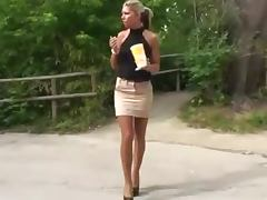 Tall blonde demonstrates her beautiful legs in the street
