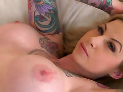 Inked blonde Hollie Hatton shows off her big tits