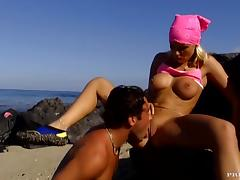 Busty blond girlfriend is getting fucked on a rocky beach