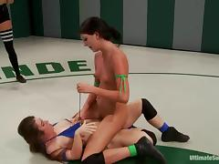 Two slim brunette chicks fight and fuck in a ring
