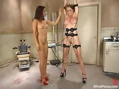Gorgeous Christina Carter gets tortured by sexy dominatrix Isis Carry the