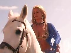 Slutty blonde gets her cunt fisted and fucked deep on a beach