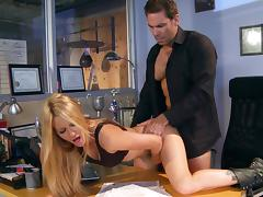 Horny Jessica Drake gets fucked from behind on an office table
