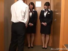 Two kinky office girls are playing with their boss