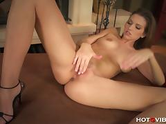 Gorgeous brunette belle rubs her sweet pink cunt