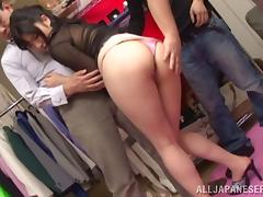 A Japanese girl is gangbanged in the back room of an office